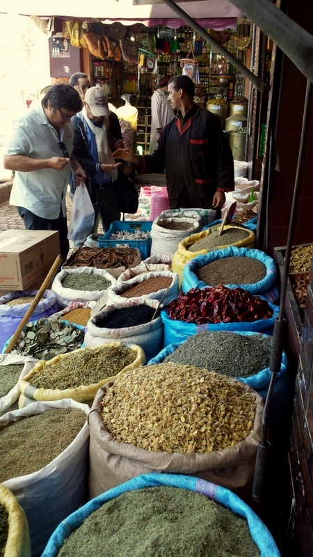 Geoff purchasing cumin from the markets in Marrakesh