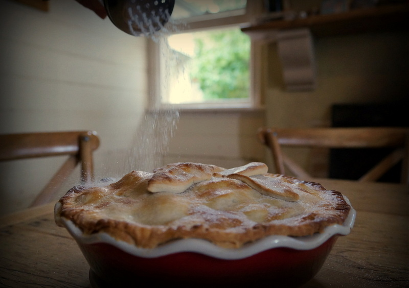 Dusting the pie with sugar